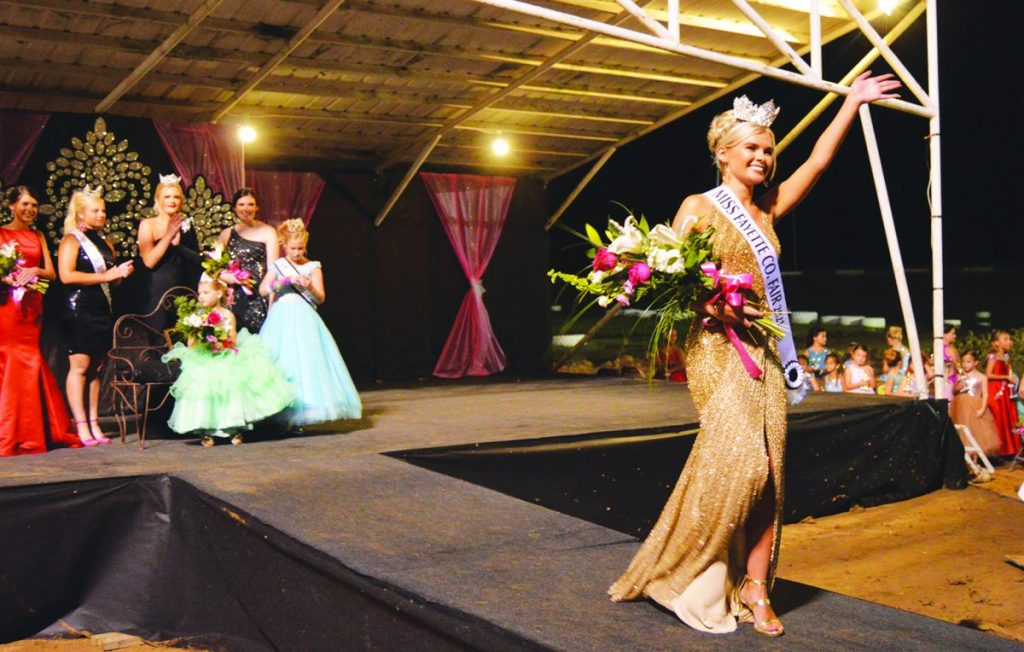 Carissa Sitki photo 2021 Miss Fayette County Fair Queen Miley Worker, waves to the crowd as she completes her first walk as queen Monday night, July 12.