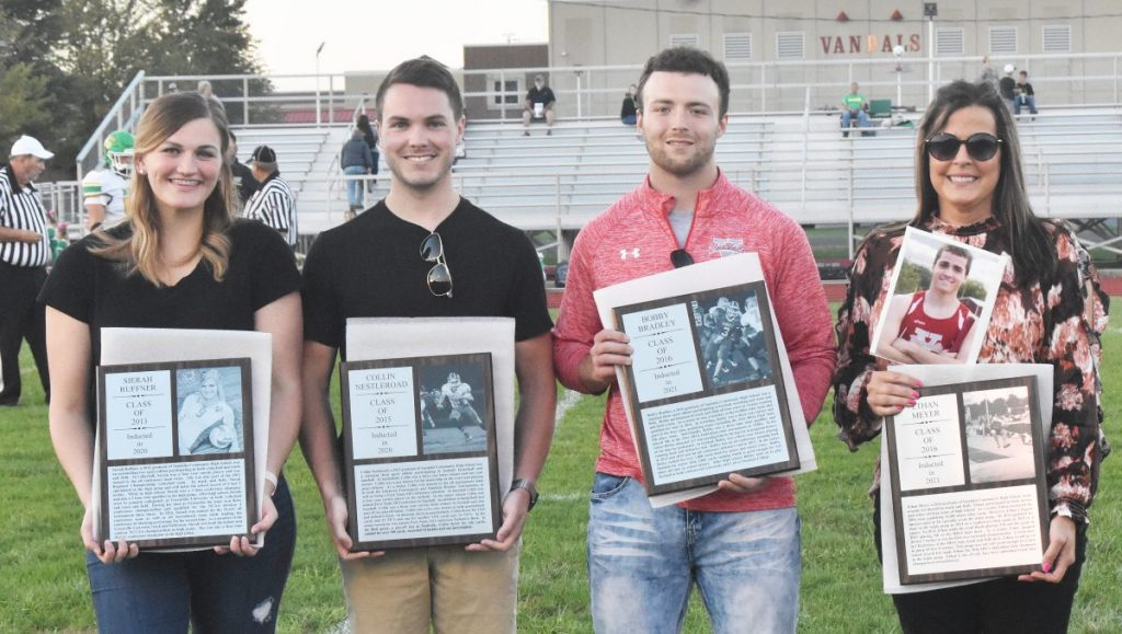 Inductees into the Vandalia Community High School's Athletic Wall of Fame were honored just prior to the Homecoming Game on Friday night before the hometown crowd. From left is Sierah Ruffner, Collin Nestleroad, Bobby Bradley and Ethan Meyer, accepted by his mother, Mindy Smith.