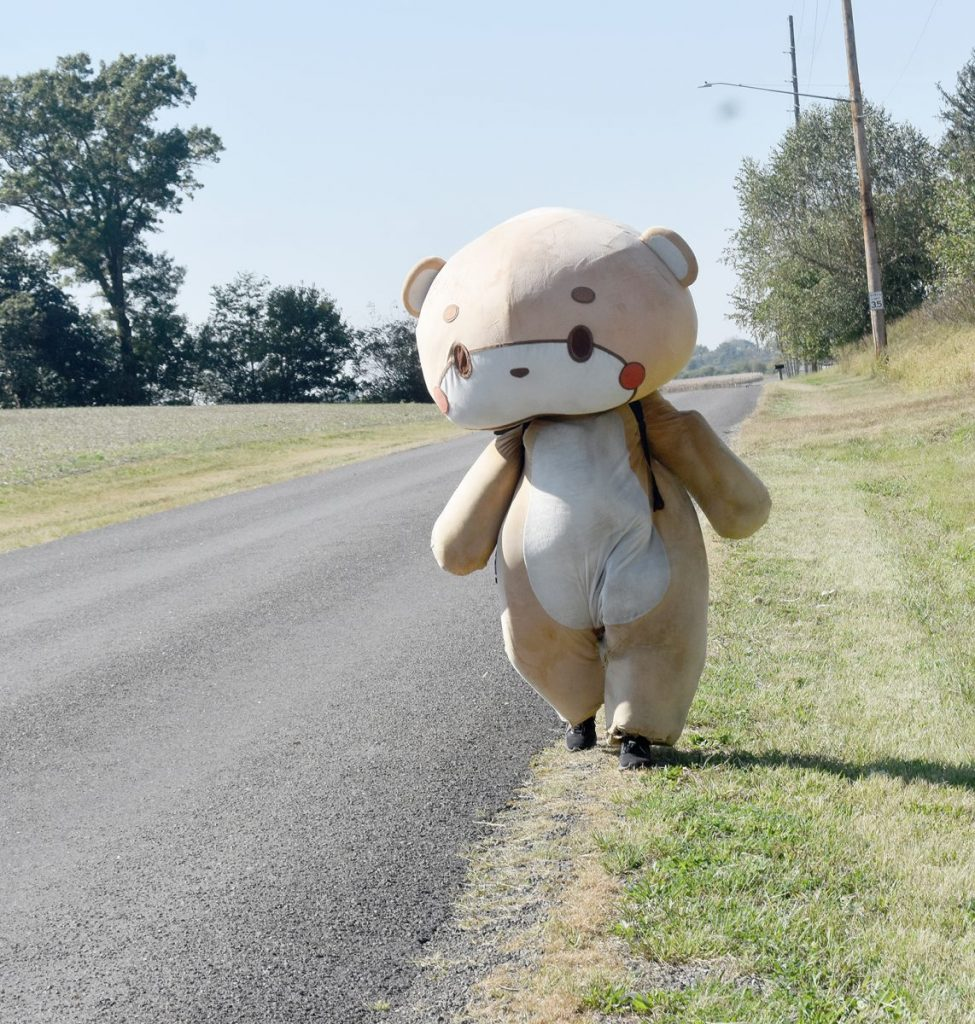 Bearsun, the alter ego of Californian Jesse Larios, walked along Route 40 through Central Illinois last week, attracting the attention of several drivers. Larios is walking across the countyto raise money for five charitable organizations.